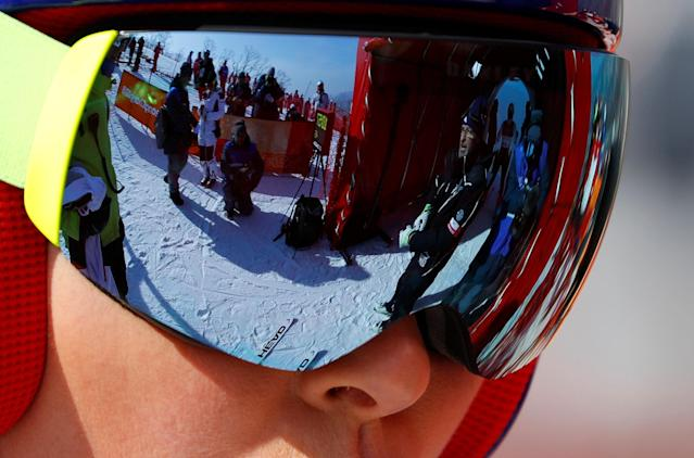 """Heinz Haemmerle, or """"Magic Heinzi"""" as US skier Lindsey Vonn calls her Austrian-born ski technician, is reflected in the ski goggles of the world's most successful skiing woman before the start of Vonn's third Olympic Downhill training run at the Winter Olympics 2018 in Pyeongchang, South Korea, February 20, 2018. REUTERS/Leonhard Foeger"""