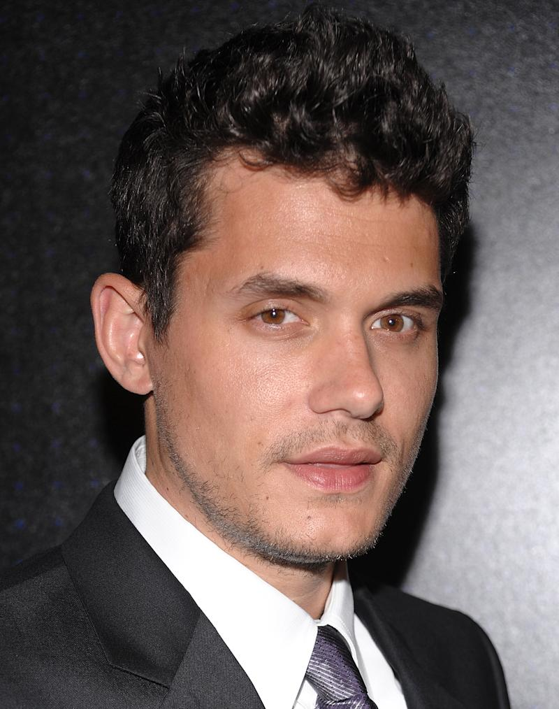"""FILE - In this Tuesday, Feb. 17, 2009 file photo, musician John Mayer attends the """"Armani 5th Avenue"""" store opening party, in New York. Taylor Swift has never revealed her target in the scathing song """"Dear John,"""" but Mayer's pretty sure it was about him. In a new Rolling Stone interview, Mayer called Swift's """"Dear John"""" cheap songwriting and said it made him feel terrible and he didn't deserve it. (AP Photo/Evan Agostini, File)"""