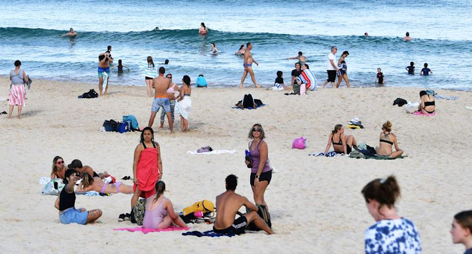 People sit at Bondi beach despite Sydney's stay at home orders. Source: Getty