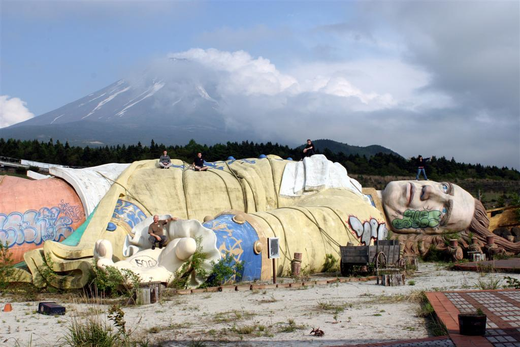 Under the shadow of Mount Fuji lies an imprisoned (and spray painted) Gulliver. Look closely and you'll see some explorers standing on the statues face, body, and hand.  (Photo: Martin Lyle)