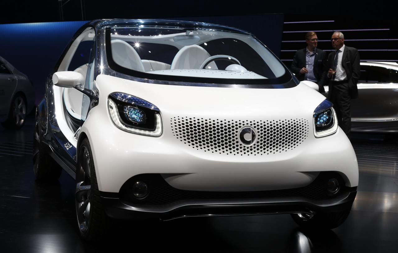 The front view of a Smart Fourjoy prototype is pictured during the world premiere of the four-seater Smart at the Smart Mercedes media night of the Frankfurt motor show September 9, 2013. The world's biggest auto show is open to the public September 14 -22. REUTERS/Wolfgang Rattay (GERMANY - Tags: BUSINESS TRANSPORT)