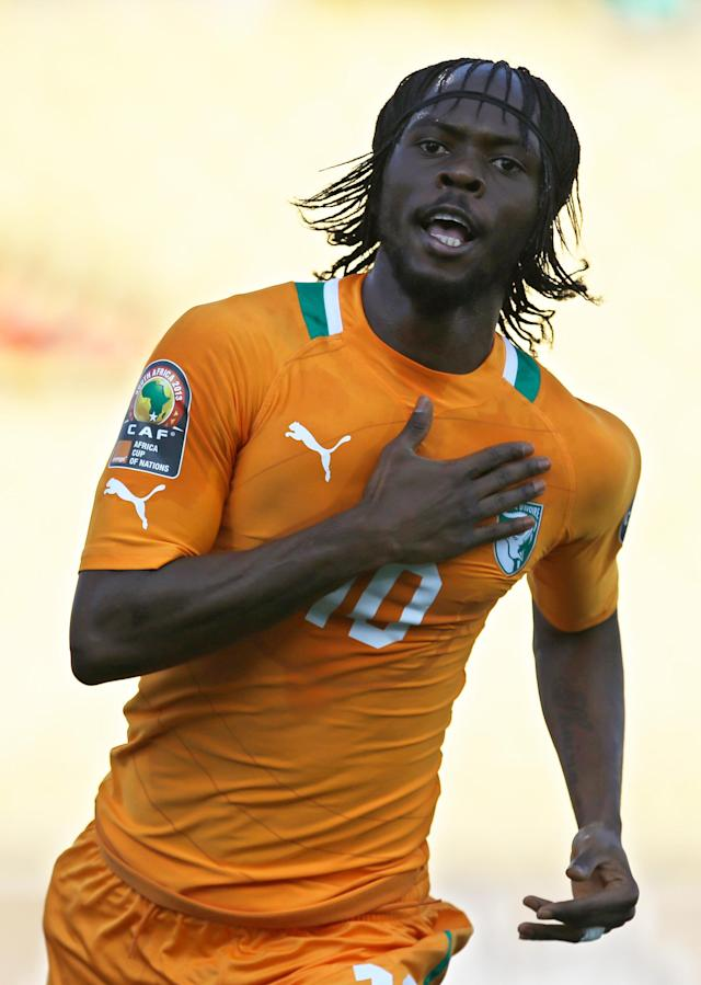 FILE - In this Jan. 26, 2013, file photo, Ivory Coast's Gervinho celebrates after scoring the opening goal against Tunisia during their African Cup of Nations group D match at the Royal Bafokeng stadium in Rustenburg, South Africa. The two other teams in group D are Togo and Algeria. (AP Photo/Armando Franca, File)