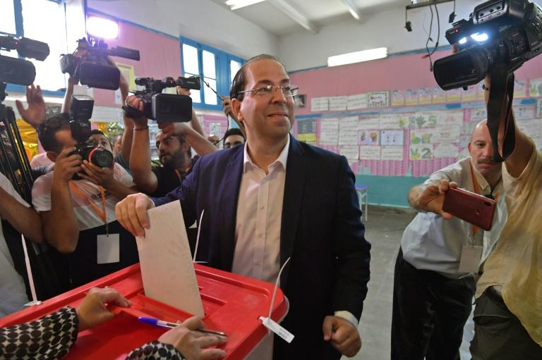Tunisian Prime Minister and presidential hopeful Youssef Chahed casts his ballot on the outskirts of the capital Tunis