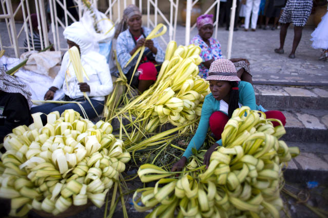 <p>Palm frond vendors sit outside St. Pierre church during Palm Sunday Mass in Petion-Ville, Haiti, Sunday, March 25, 2018. For Christians, Palm Sunday marks Jesus Christ's entrance into Jerusalem when his followers laid palm branches in his path, prior to his crucifixion. (Photo: Dieu Nalio Chery/AP) </p>