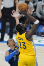 Golden State Warriors forward Draymond Green (23) shoots in front of Oklahoma City Thunder forward Darius Bazley (7) in the second half of an NBA basketball game Wednesday, April 14, 2021, in Oklahoma City. (AP Photo/Sue Ogrocki)