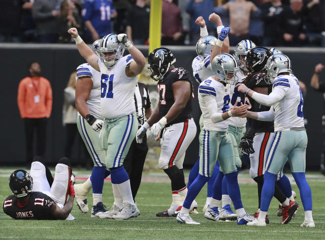 Dallas Cowboys kicker Brett Maher and teammates celebrate his game winning field goal for a 22-19 victory over the Falcons. (AP)