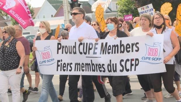 The marches were organized by CUPE N.B. and were held in 13 locations across the province, including Fredericton, Saint John and Moncton. (Mrinali Anchan/CBC - image credit)