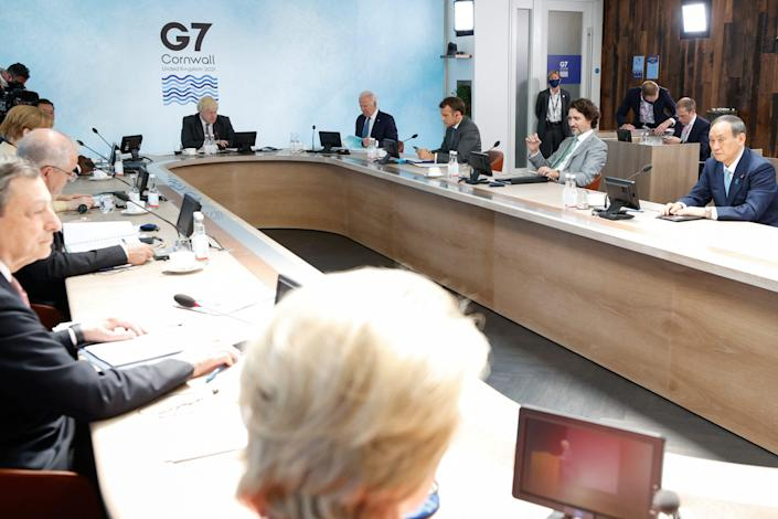 (L-R) Italy's Prime Minister Mario Draghi, German Chancellor Angela Merkel, Britain's Prime Minister Boris Johnson, US President Joe Biden, France's President Emmanuel Macron, Canada's Prime Minister Justin Trudeau and Japan's Prime Minister Yoshihide Suga attend a plenary session during G7 summit in Carbis Bay, Cornwall on June 13, 2021.