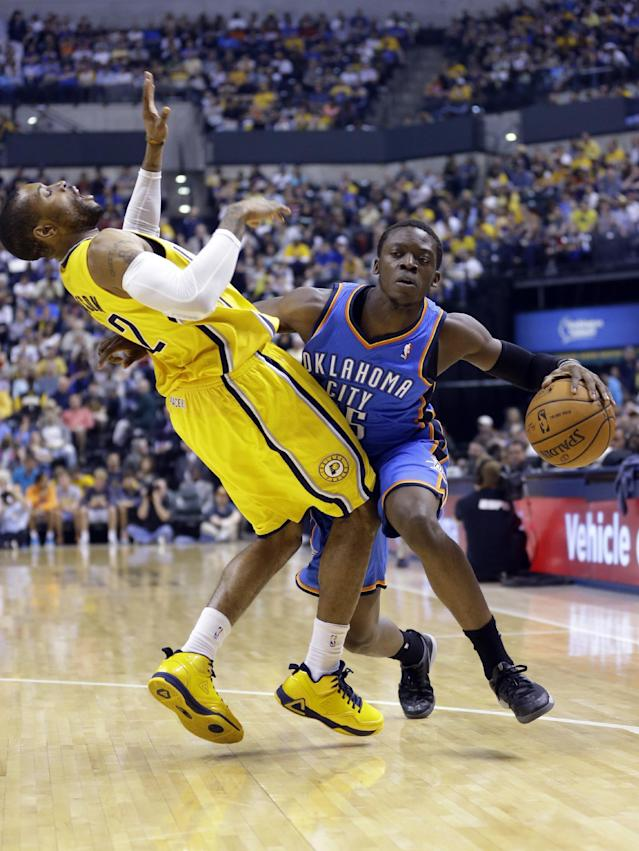 Indiana Pacers guard C.J. Watson, left, draws an offensive foul from Oklahoma City Thunder guard Reggie Jackson in the second half of an NBA basketball game in Indianapolis, Sunday, April 13, 2014. (AP Photo/Michael Conroy)