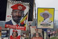 Elections billboards for Uganda's President Yoweri Museveni, and opposition leader and presidential candidate Robert Kyagulanyi, also known as Bobi Wine, are seen on a street in Kampala