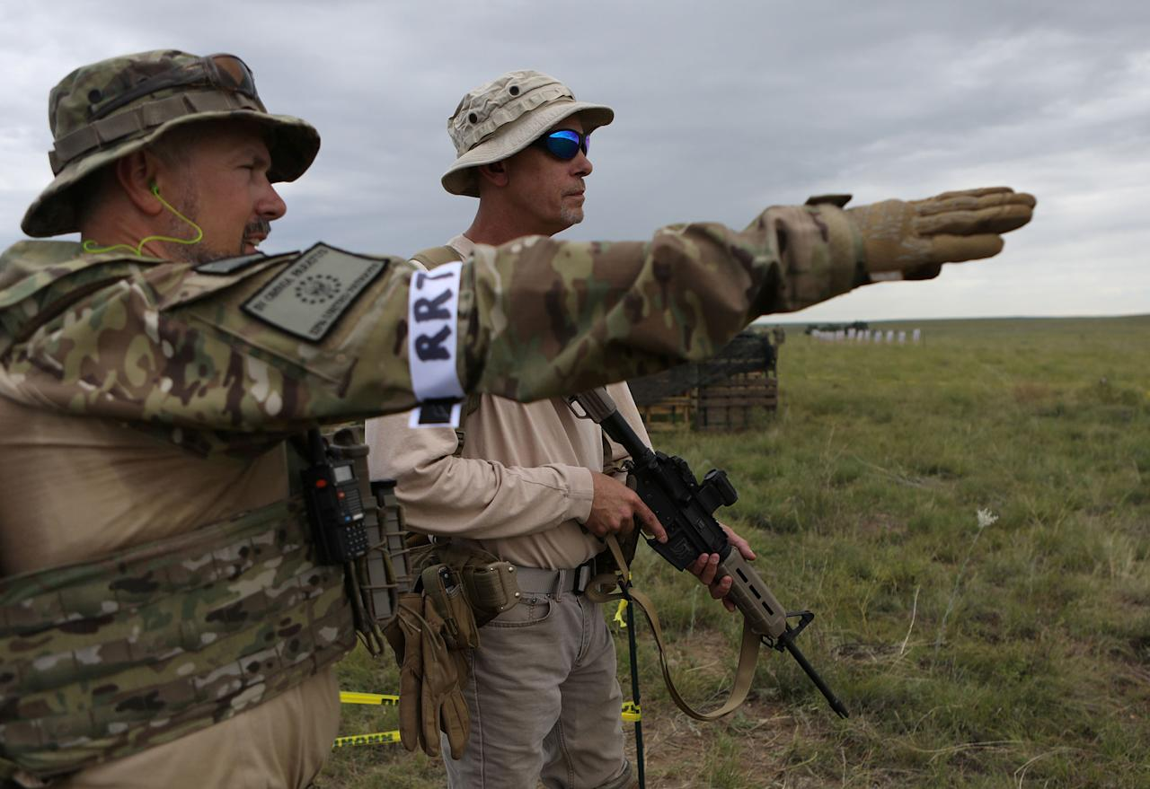 <p>Members of self-described patriot groups and militias prepare to run through shooting drills during III% United Patriots' Field Training Exercise outside Fountain, Colo., July 29, 2017. (Photo: Jim Urquhart/Reuters) </p>