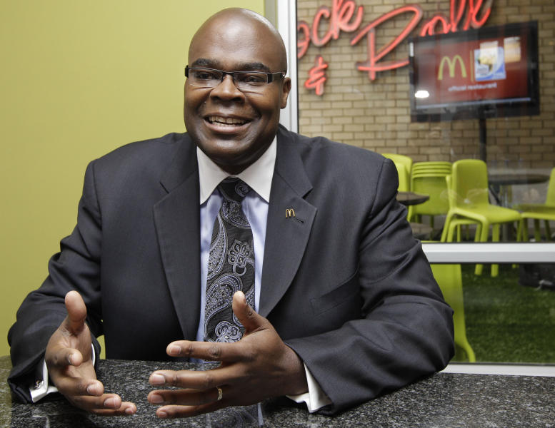 """<p> FILE - In this Thursday June 10, 2010, file photo, McDonald's President Don Thompson,speaking during an interview with the Associated Press in Sandton, Johannesburg, South Africa. McDonald's CEO Don Thompson revealed at an analyst conference during the last week of May 2013 that he shed about 20 pounds in the past year by """"working out again,"""" but still eats McDonald's every day. (AP Photo/Yves Logghe, File)"""