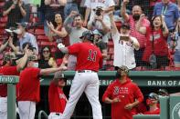 Boston Red Sox's Rafael Devers (11) celebrates his three-run home run during the fifth inning of a baseball game against the Los Angeles Angels, Sunday, May 16, 2021, in Boston. (AP Photo/Michael Dwyer)