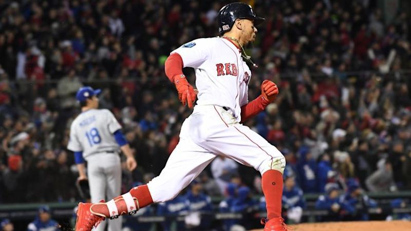 BOSTON, MA WEDNESDAY, OCTOBER 24, 2018 As Dodger pitcher Kenta Maeda looks on, Red Sox Mookie Betts hits a double in the 7th inning of game two of the World Series at Fenway Park.