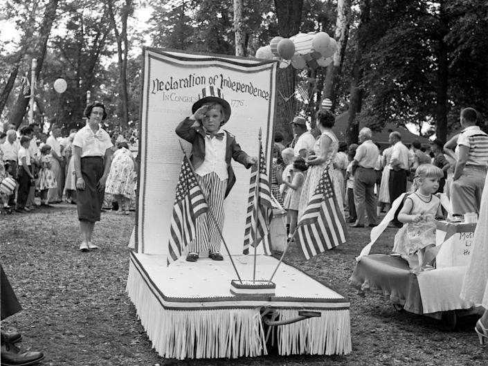 A boy stands on a miniature float at the baby parade in Lititz Park, Pennsylvania, in 1955.