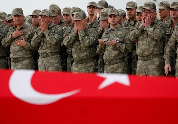 FILE PHOTO: Turkish soldiers pray before the flag-wrapped coffin of their comrade Sefa Findik, who was killed in the military operation in northeast Syria, during a ceremony in Sanliurfa