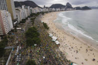 People gather along Copacabana Beach in a demonstration backing President Jair Bolsonaro's anti-coronavirus-lockdown stance, marking May Day, or International Workers' Day, in Rio de Janeiro, Brazil, Saturday, May 1, 2021. Brazil has seen over 400,000 confirmed COVID-19 deaths, a toll second only to the United States. (AP Photo/Lucas Dumphreys)