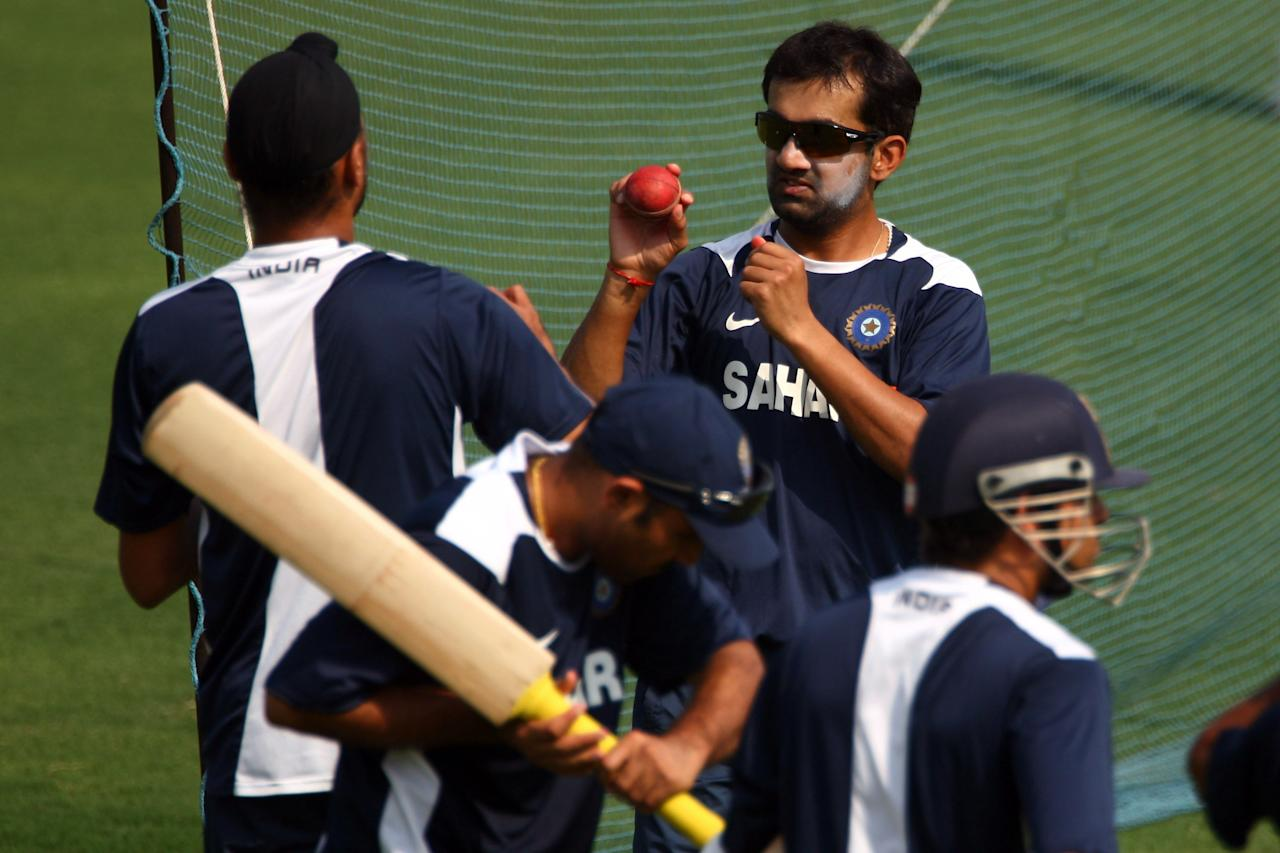 NAGPUR, INDIA - NOVEMBER 05:  Gautam Gambhir (r) who is suspended for the fourth Test match talks to Harbhajan Singh (l) during an Indian nets session at Vidarbha Cricket Association Stadium on November 5, 2008 in Nagpur, India.  (Photo by Michael Steele/Getty Images)