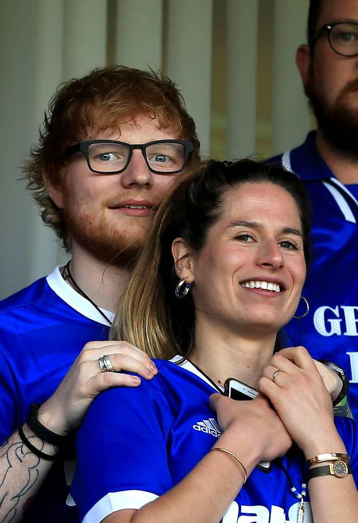 Ed Sheeran and Cherry Seaborn attend a sports game in England
