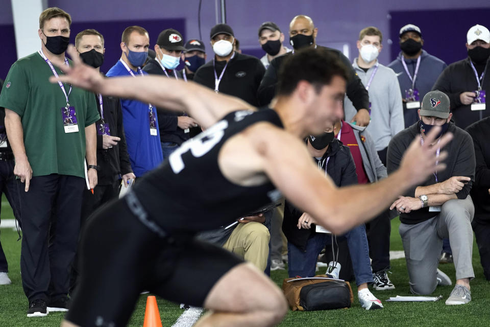 FILE - In this March 9, 2021, file photo, scouts from all 32 NFL teams attend Northwestern's Pro Day football workout Tuesday, in Evanston, Ill. Teams are now sending scouts, coaches and general managers across the country for 103 college pro days replacing this year's combine in yet another NFL adaptation to the coronavirus pandemic. (AP Photo/Charles Rex Arbogast, File)