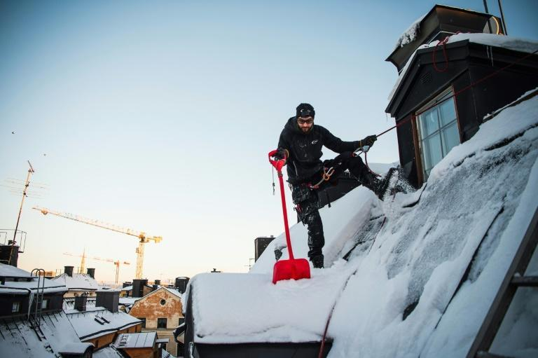 The constant clearing of snow from the city's roofs is first and foremost done for people's safety, but also to maintain the buildings, many of which are hundreds of years old