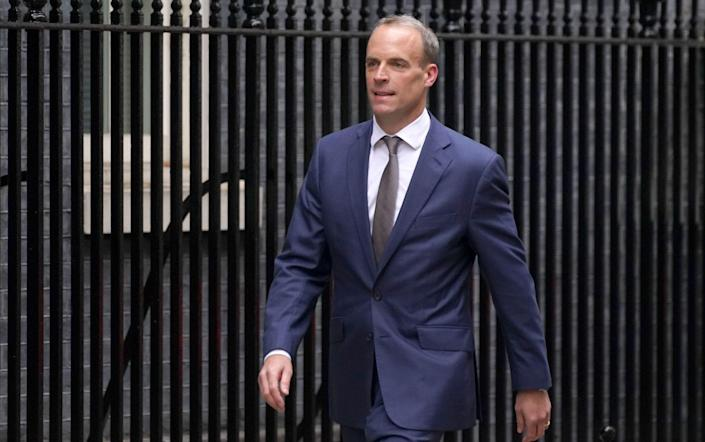 Dominic Raab arriving in Downing Street, London, as Boris Johnson carried out a Cabinet reshuffle - Stefan Rousseau/PA