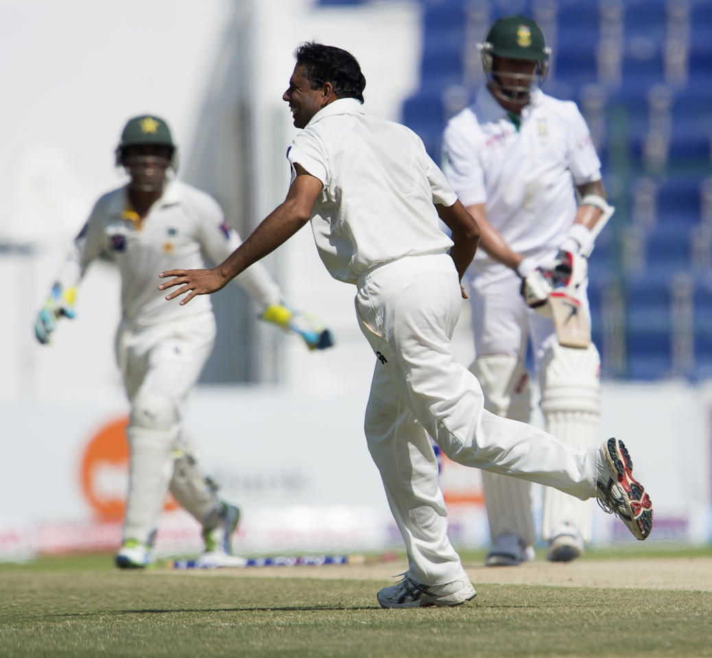 Pakistan bowler Zulifqar Babar celebrates his wicket over Dale Steyn on the fourth day of their first Test against South Africa at the Sheikh Zayed Cricket Stadium in Abu Dhabi on October 17, 2013. AB de Villiers hit a fighting fifty to delay Pakistan's victory march over South Africa on the fourth day of the first Test in Abu Dhabi today. AFP PHOTO/STR        (Photo credit should read STR/AFP/Getty Images)