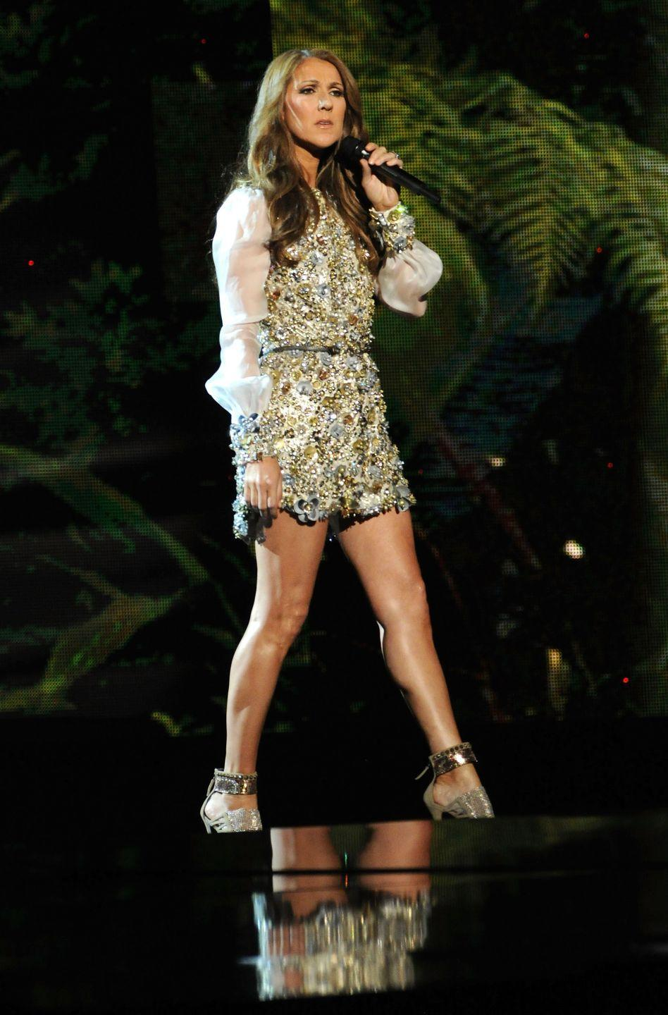 <p>No stranger to gems and baubles, Dion wore a beaded minidress with translucent bell sleeves to perform for the Grammy's. The elaborate beading is more and more beautiful the longer you look.</p>