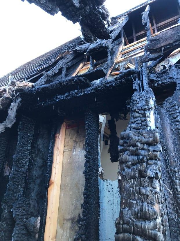 This structure was most heavily damaged in the fire, along with an adjacent fence and door.