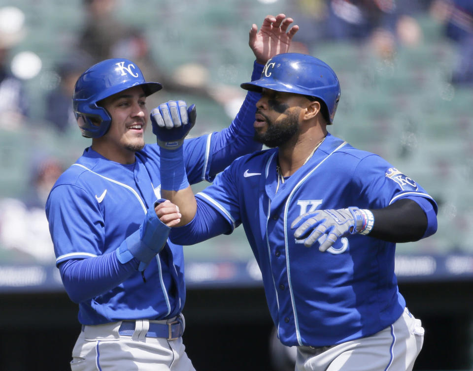 Kansas City Royals' Carlos Santana, right, celebrates with second baseman Nicky Lopez after hitting a two-run home run against the Detroit Tigers during the third inning of a baseball game Monday, April 26, 2021, in Detroit. (AP Photo/Duane Burleson)