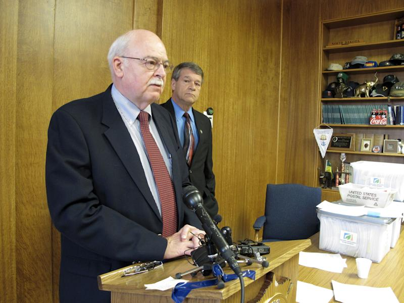 North Dakota Secretary of State Al Jaeger, left, speaks while North Dakota Attorney General Wayne Stenehjem listens at a news conference on the results of an investigation into petition fraud, Tuesday, Sept. 4, 2012 in Stenehjem's office at the Capitol in Bismarck, N.D., Two proposed ballot measures _ to create a North Dakota conservation fund and make marijuana use legal for medical treatments _ were disqualified from the ballot because hundreds of the initiative petition signatures were allegedly forged or made up. Eight North Dakota State University football players are among the 11 petition circulators who are facing charges. (AP Photo/Dale Wetzel)