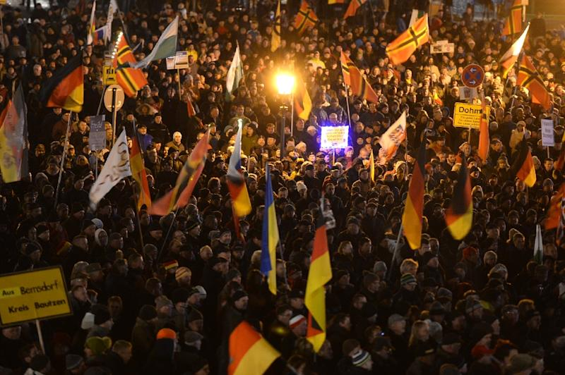 "Supporters of the PEGIDA movement, ""Patriotic Europeans Against the Islamisation of the Occident"", gather at a protest rally on November 23, 2015 in Dresden, eastern Germany (AFP Photo/Arno Burgi)"