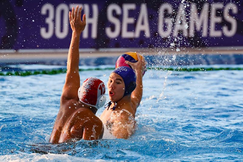 Kun Yang Chiam (blue cap) of Singapore prepares to pass the ball during their match against Indonesia for the water polo event of the 30th SEA Games held at the New Clark City Aquatics Center in Capas town, province of Tarlac, Philippines on November 28, 2019. (Photo by George Calvelo/NurPhoto via Getty Images)