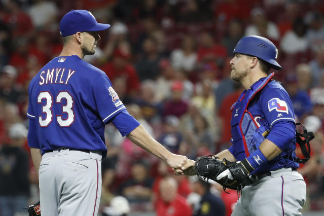 Texas Rangers relief pitcher Drew Smyly (33) celebrates with catcher Tim Federowicz, right, after closing the ninth inning of a baseball game against the Cincinnati Reds, Friday, June 14, 2019, in Cincinnati. (AP Photo/John Minchillo)