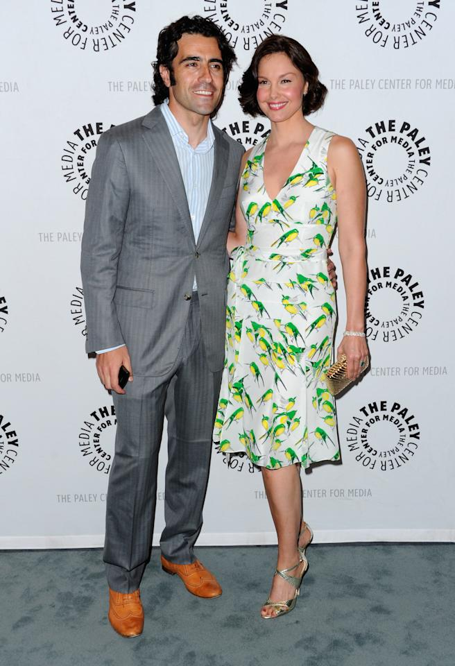 """BEVERLY HILLS, CA - APRIL 10:  Racecar driver Dario Franchitti and actress Ashley Judd arrive to The Paley Center for Media presents A Screening of ABC's """"Missing"""" at The Paley Center for Media on April 10, 2012 in Beverly Hills, California.  (Photo by Alberto E. Rodriguez/Getty Images)"""