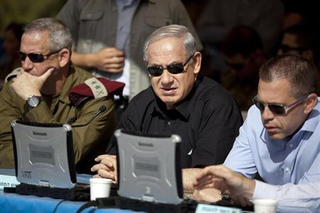 Israeli PM Netanyahu sits next to armed forces chief Gantz and minister Erdan during a drill in Jerusalem