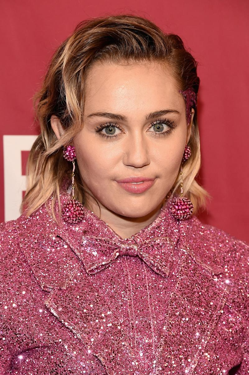 "Miley Cyrus Gets ""Dad"" Tattoo"