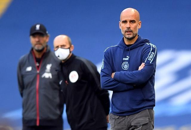 Pep Guardiola (right) is not expecting a repeat of City's 4-0 win over Liverpool in July