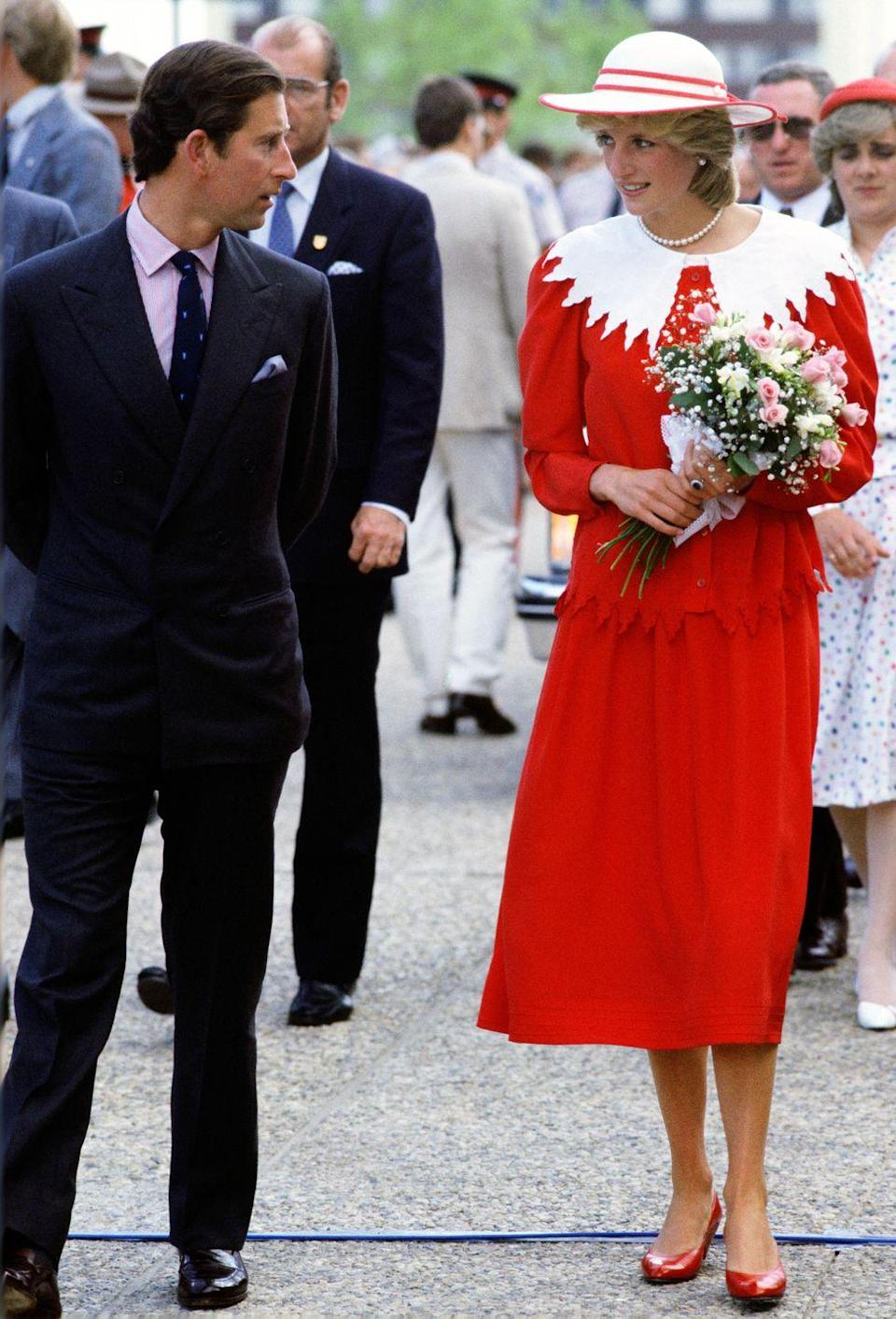 <p>In a red-and-white top, skirt, matching hat and ballet flats during the Royal Tour of Canada. </p>