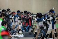 Athletes at a shooting test event for the Tokyo Olympics at Asaka shooting range