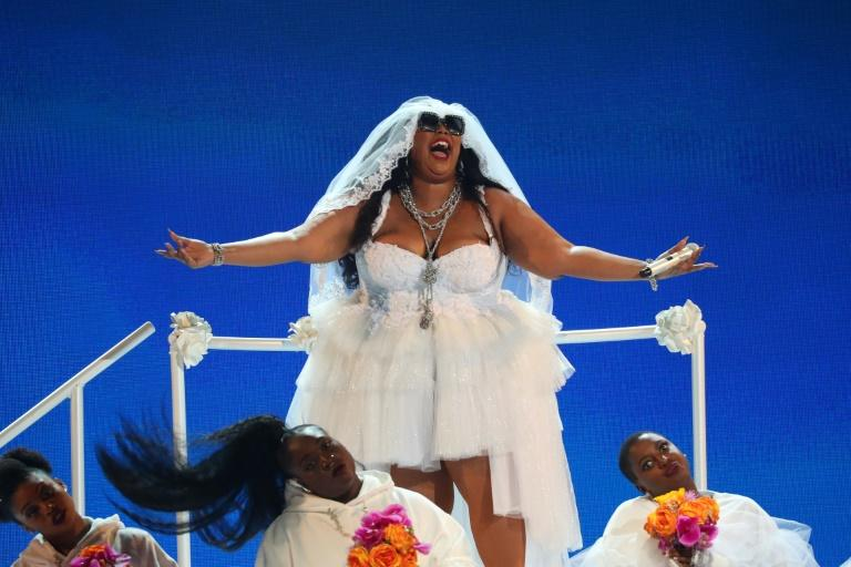 "Lizzo drew the crowd to its feet during her show-stopping performance of ""Truth Hurts"" at the 2019 BET awards"