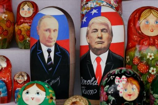 Russian dolls depicting Russian President Vladimir Putin (L) and his US counterpart Donald Trump are seen on sale at Izmailovo flea market in Moscow