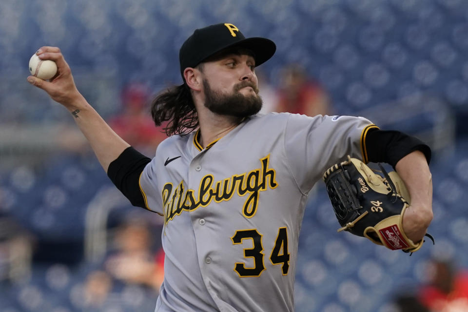 Pittsburgh Pirates starting pitcher JT Brubaker (34) delivers during the first inning of a baseball game against the Washington Nationals, Monday, June 14, 2021, in Washington. (AP Photo/Carolyn Kaster)