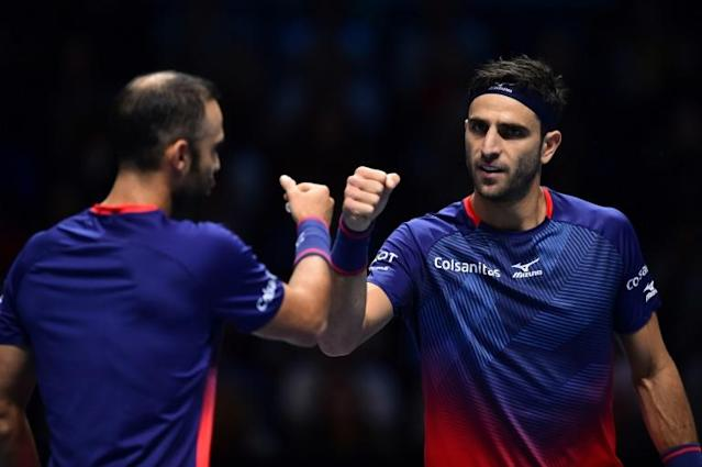 Colombia's Robert Farah (R) has been cleared of an anti-doping violation (AFP Photo/Glyn KIRK )