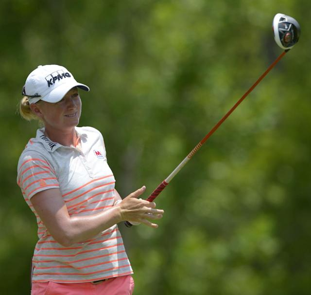 Stacy Lewis watches the flight of her tee shot on the fourth hole in the final round of the Airbus LPGA Classic golf tournament at Magnolia Grove on Sunday, May 25, 2014, in Mobile, Ala. (AP Photo/G.M. Andrews)