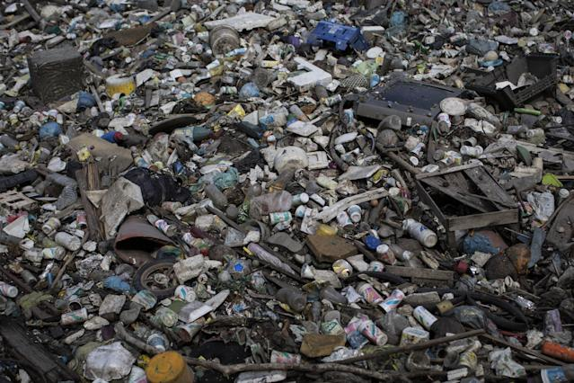 In this May 15, 2014 photo, trash floats on a polluted water channel that flows into the Guanabara Bay in Rio de Janeiro, Brazil. With just over two years to go until the Rio Olympics, nearly 70 percent of the sewage in the metropolitan area of 12 million inhabitants continues to flow untreated, along with thousands of tons of garbage daily, into area rivers, the bay and even Rio's famed beaches like Copacabana and Ipanema.Several Olympic sports federations raised fears that Rio's polluted waters could prove harmful to athletes' health. Exposure to fecal matter can cause Hepatitis A, dysentery, cholera other diseases