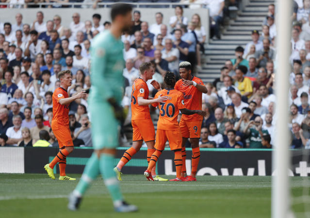 Newcastle's Joelinton, right, celebrates after scoring his side's first goal during the English Premier League soccer match between Tottenham Hotspur and Newcastle United at Tottenham Hotspur Stadium in London, Sunday, Aug. 25, 2019.(AP Photo/Frank Augstein)
