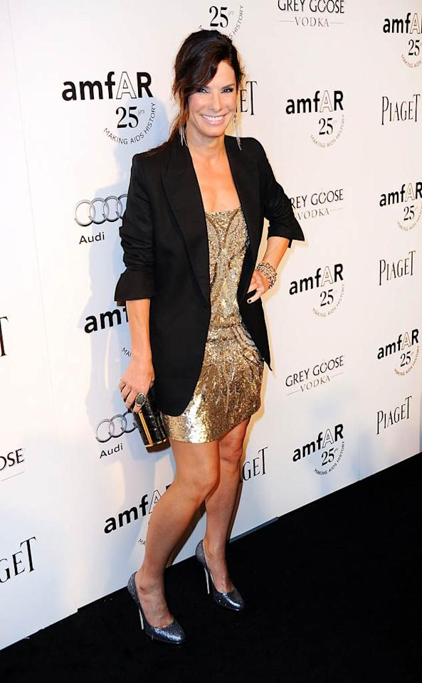 """Sandra Bullock was decked out in an AllSaints mini dress and a Stella McCartney tuxedo jacket at Thursday's amfAR Inspiration Gala at the Chateau Marmont in L.A. And the Oscar winner even took home a treat for her 1-year-old son Louis: an Andy Warhol """"Peaches"""" print that her agents bought in the auction for $14,000! All proceeds were to benefit amfAR's AIDS research.   (10/27/2011)"""