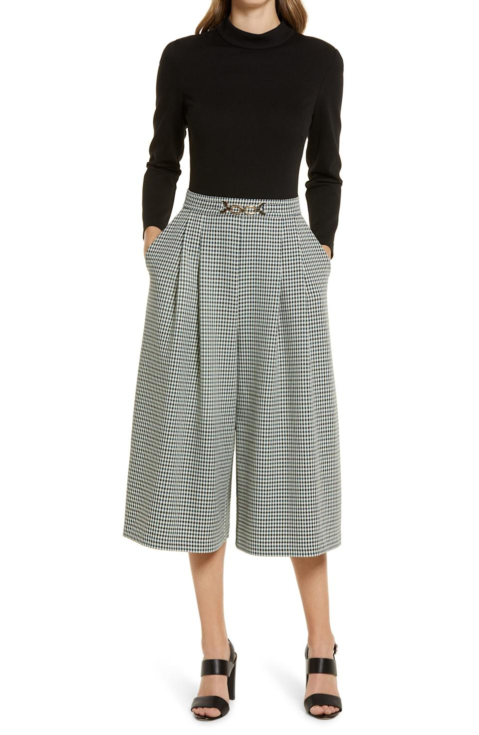 """<p><strong>ELIZA J</strong></p><p>nordstrom.com</p><p><a href=""""https://go.redirectingat.com?id=74968X1596630&url=https%3A%2F%2Fwww.nordstrom.com%2Fs%2Feliza-j-twoffer-wide-leg-jumpsuit%2F5607769&sref=https%3A%2F%2Fwww.harpersbazaar.com%2Ffashion%2Ftrends%2Fg36946278%2Fnordstrom-anniversary-sale-fashion%2F"""" rel=""""nofollow noopener"""" target=""""_blank"""" data-ylk=""""slk:Shop Now"""" class=""""link rapid-noclick-resp"""">Shop Now</a></p><p><strong>Sale: $100</strong></p><p><strong>After Sale: $168</strong></p><p> If you're returning to an office setting soon, this jumpsuit will come in handy as it requires bare minimum effort while being immensely chic. </p>"""