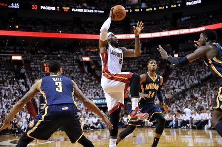 May 26, 2014; Miami, FL, USA; Miami Heat forward LeBron James (6) drives to the basket against the Indiana Pacers in game four of the Eastern Conference Finals of the 2014 NBA Playoffs at American Airlines Arena. Mandatory Credit: Steve Mitchell-USA TODAY Sports